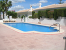 private communal swimming pool and garden area