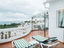 Large unoverlooked balcony with superb views over the Med