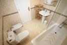 En-suite bathroom with shower over full length bath.