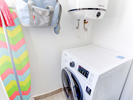 laundry room with washing machine-dryer