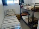 Bedroom 2 with single and bunk beds