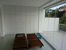 Glass area with storage cupboards